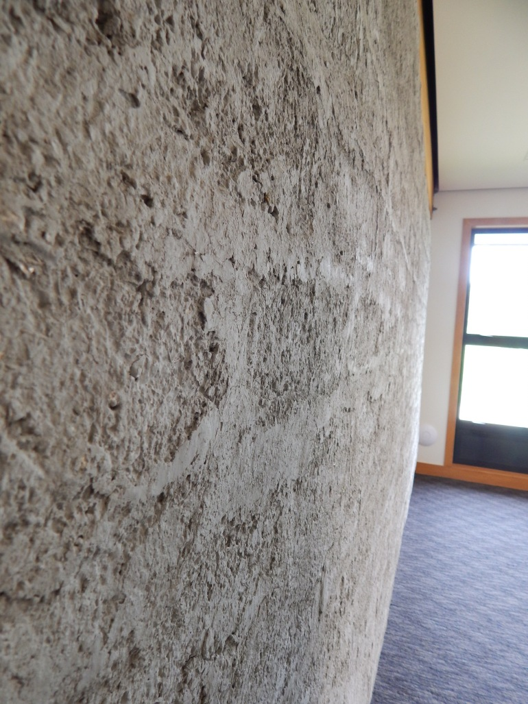Textured adobe wall keeps the room warm in winter, cool in summer!