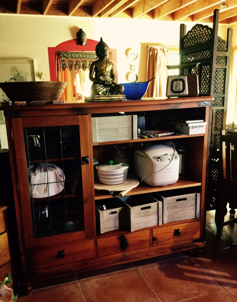 Another repurposed TV cabinet serves as additional kitchen storage.