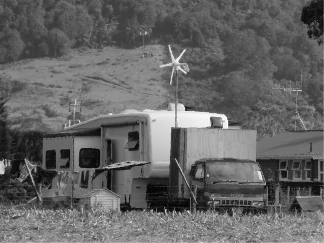 Somebody's little mobile home.  Note the wind vane for power generation!